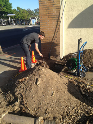 Garland plumbing contractor snakes a commercial drain line